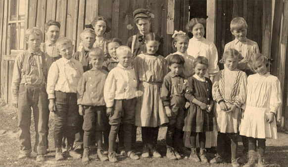 Douglas Falls School 1909 (near Northport) - Gladys Allen, teacher; pupils Earl and Ellen Tucker, Lois Mizmer, Maurice, Jack and Gladys Crawford, and Emery Ricketts. Harold Douglas 4th from left with white hair, 2nd grade (shared by Mary Ellen Long)